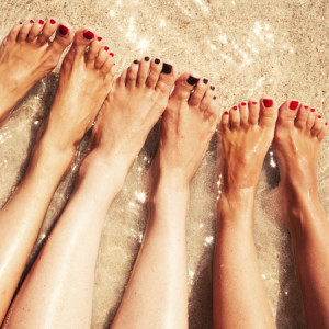 get-your-feet-ready-for-summer-holiday-beach-body-toe-nails-cracked-heels-women-on-holiday-woman-foot-sand-sea